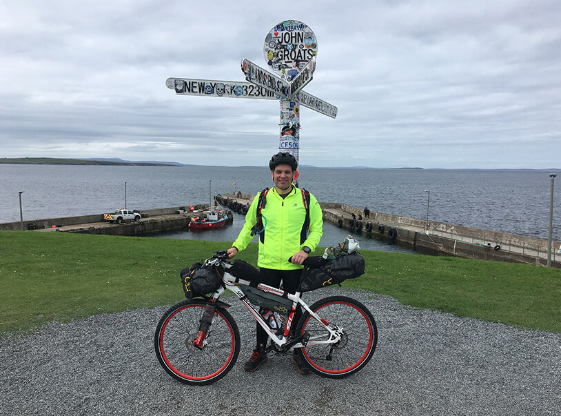 Me in front of john o groats signpost