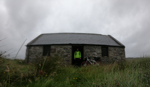 Me stood in the door way of a Scottish Bothy