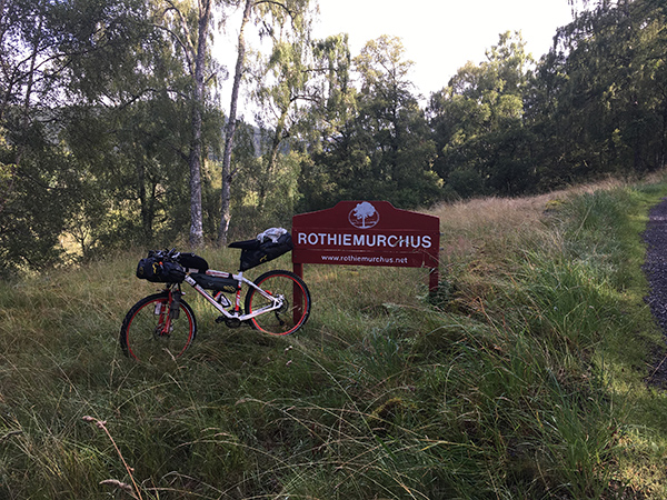 Bike against rothiemurchus sign post