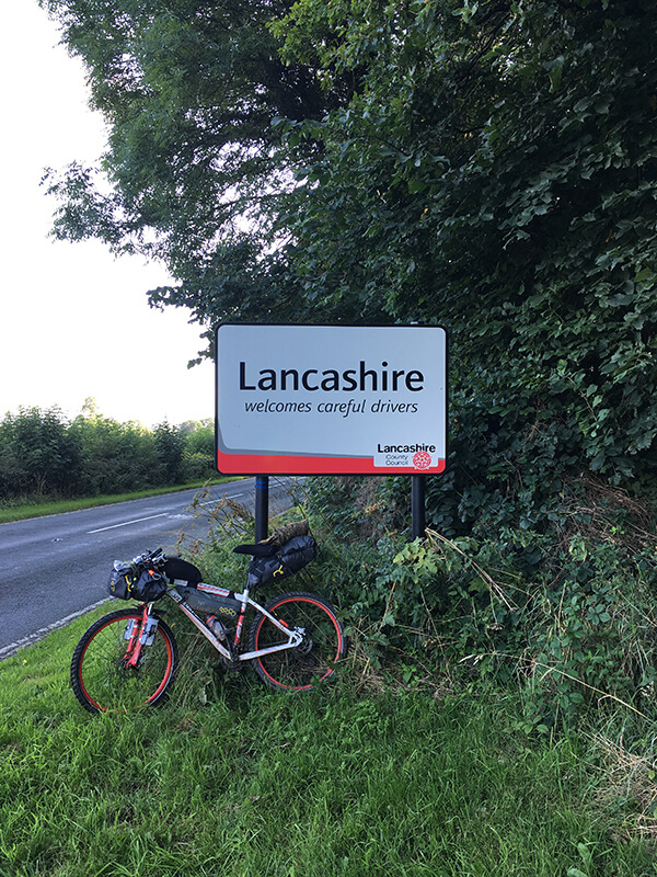 Bicycle leant against Lancashire Sign